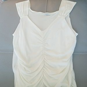 Simple yet classy white sleeveless blouse